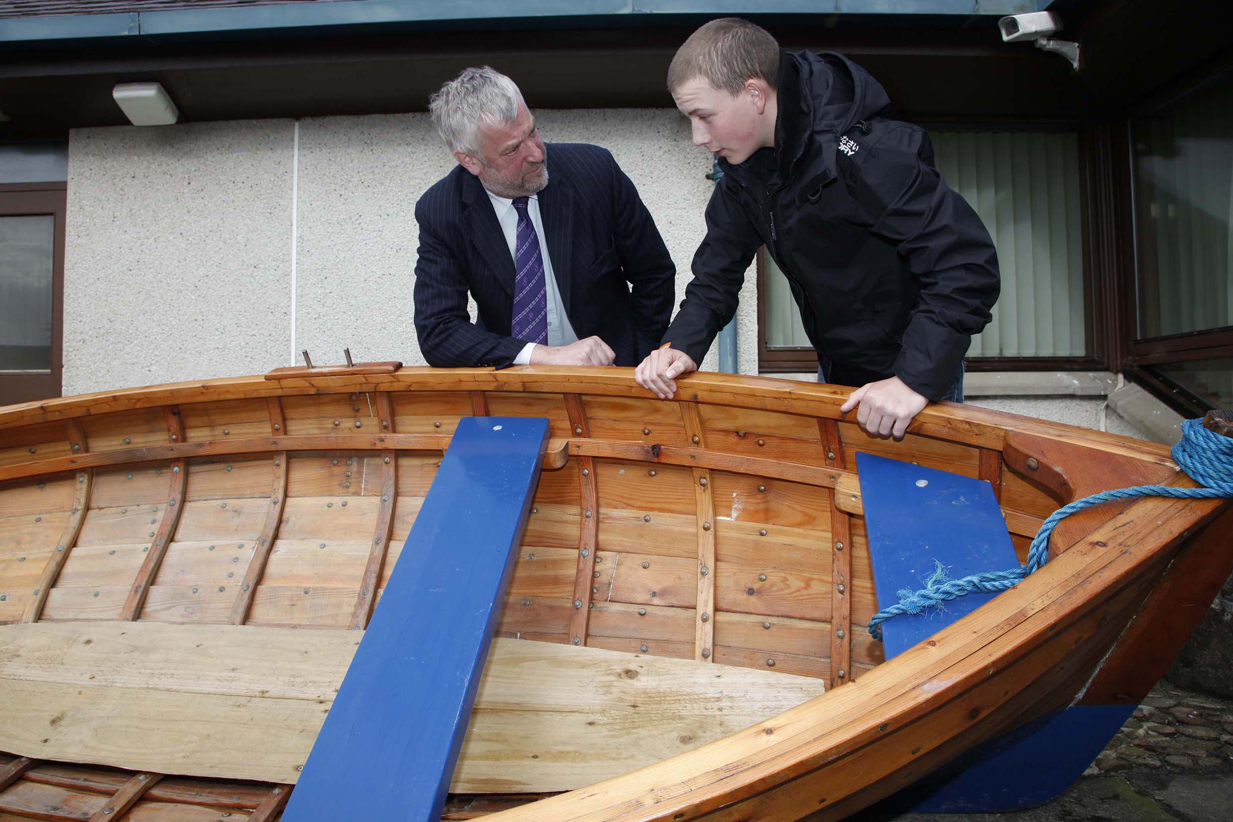 Presiding Officer Alex Fergusson is shown a Grimsay boat by Duncan MacDonald, 2010.