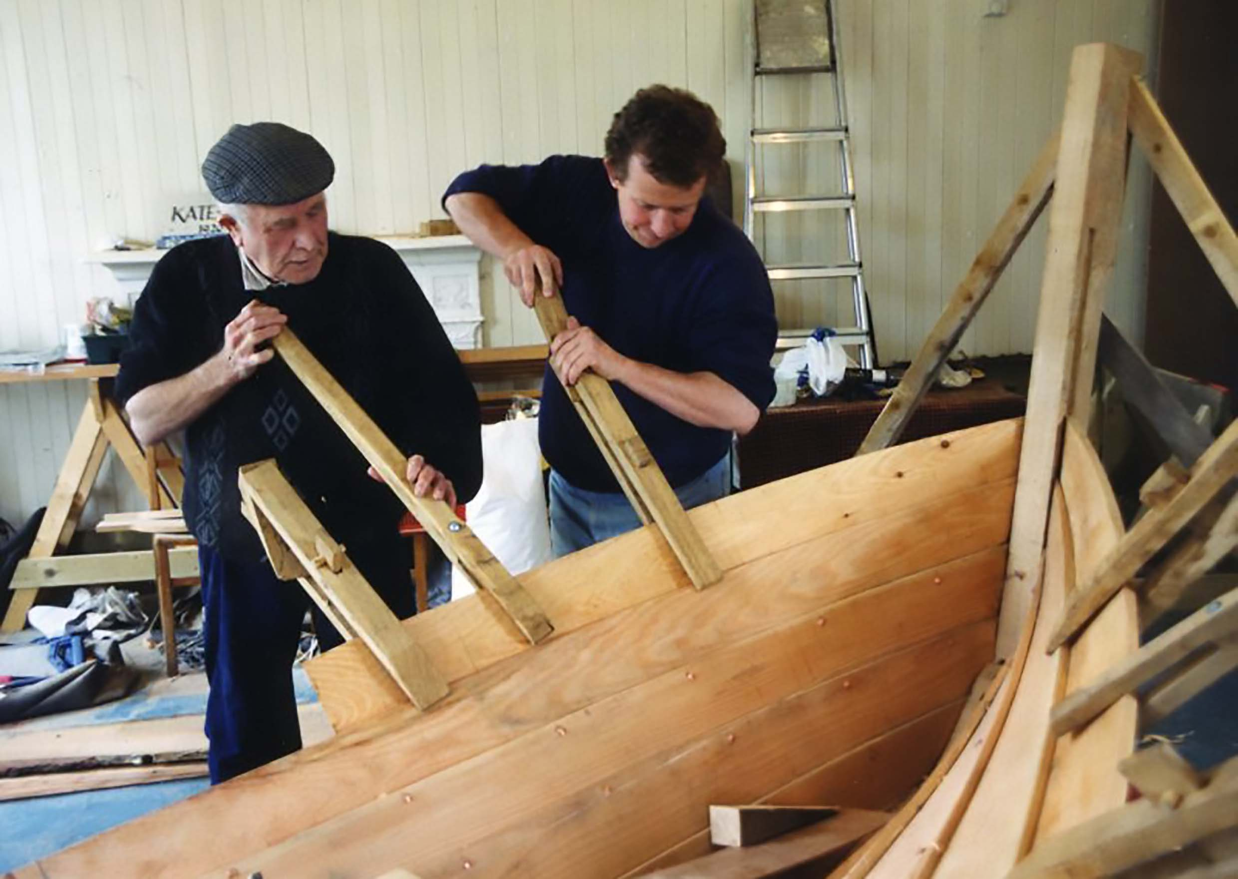 Boat Building tutors working on a Grimsay boat.